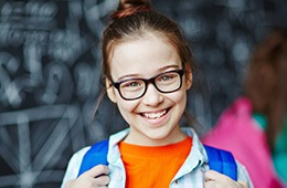 girl with glasses smiling