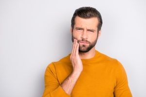 frowning man needs to visit periodontal dentist in Concord