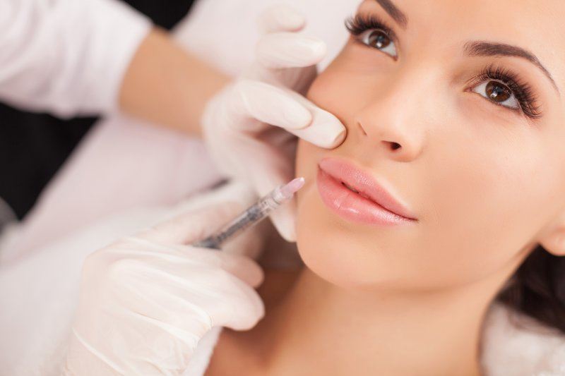 BOTOX being injected around a patient's lips